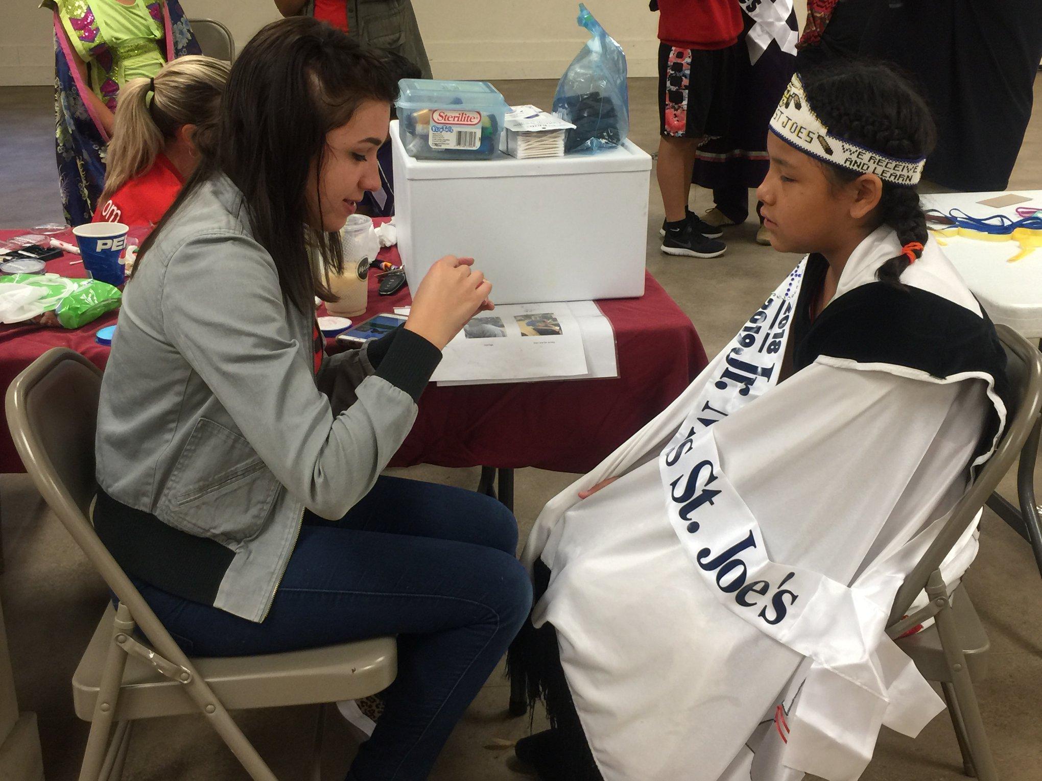 Alexis facepainting Jr. Miss St. Joe's at St. Josephs Indian School